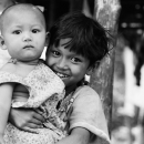 Girl Holding A Baby @ Myanmar