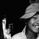 Boy Wearing A Cap Smiled