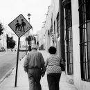 Old Couple And A Street Sign