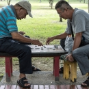 Men Playing Chinese Chess
