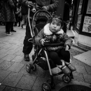 Little Girl On A Baby Buggy