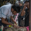 People Scrutinizing Phra Kruang