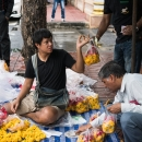 Man Selling Floral Offerings
