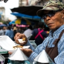 Street Vendor Having Lunch