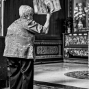 Older Woman In Front Of An Altar