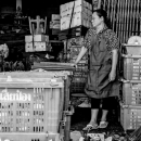 Woman Standing Between Baskets