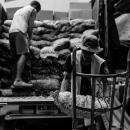 Men Unloading Bags From Truck