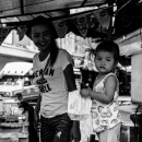 Little Girl Playing In A Food Stall