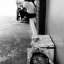 Woman Taking A Nap In Passage