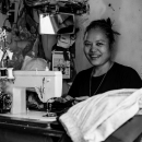Woman And Power-operated Sewing Machine
