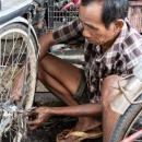 Man Repairing Pedicab