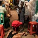 Men Lolling About In Market
