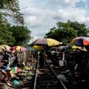 Colorful Umbrella On Railroad