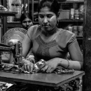 Woman Sewing In The Market