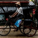 Hat, Longyi And Pedicab