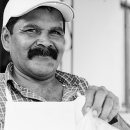 Man With Mustache At A Taco Stand