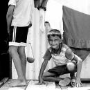 Crouching Boy's Smile