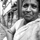 Woman Wearing Saree By The Battered Fence @ India