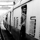 Man At A Door Of A Train @ India