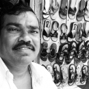 Man Working In A Shoe Shop @ India