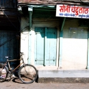 Bicycle In Front Of A Shuttered Shop