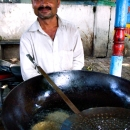 Man, Big Pot And Ladle @ India
