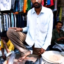 Bearded Man In A Clothing Stall @ India
