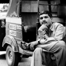 Driver Of Autorickshaw Sat Cross-legged