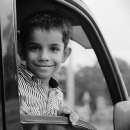 Boy Smiles In The Car