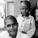 Shaven-headed Man And Boy @ India