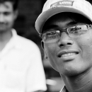 Man Wearing Glasses And A Cap @ India