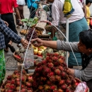 Man Selling Rambutan And Sugar Apple