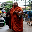Buddhist Monks In The Street Market