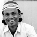 Man Wearing A Cap Smiles @ India