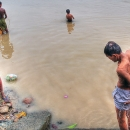 People Soaking In The Hooghly River