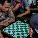 Men Around Checkered Board