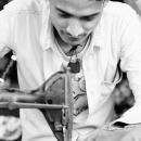 Young Man Sews @ India