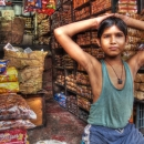 Boy In A Shop Filled With Biscuits @ India