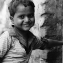 Boy Placing His Hand On The Wall @ India