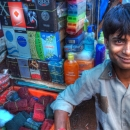 Young Man At A Street Stall