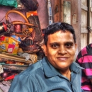 Two Men In Front Of A Junkyard @ India