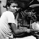 Man Beside A Motorbike @ India