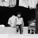 Girl At A Storefront Of A Clothier @ India