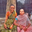 Two Women Wearing A Saree