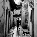 Silhouette With An Umbrella In The Lane