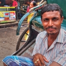 Rickshaw Wallah Wearing A Striped Shirt @ India