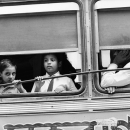 Kids By The Window Of A Bus