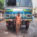 Man Istanding N Front Of A Big Truck