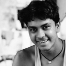 Smile Of A Young Man Wearing A Tank Top @ India