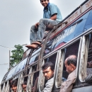 Man On The Roof Of A Bus @ India